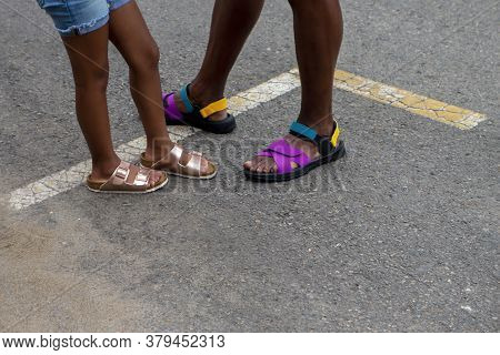 Young African American Girl On Black Top Steet With Her Father In Shorts And Sandals