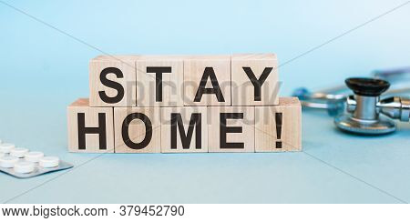 Wooden Blocks Write The Word Stay Home For Prevent And Spread Of Coronavirus Or Covid-19 Concept