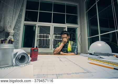 Contractor Serious And Stress For Work, Engineer Sitting Working In Office, He Has Pressure And Seri