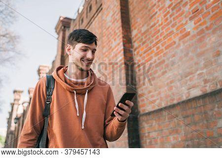 Man Using His Mobile Phone.