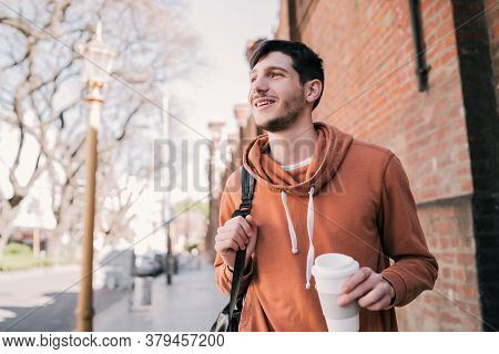 Young Man Walking On The Street.