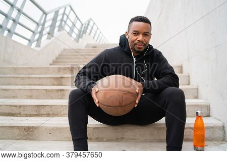 Athletic Man Holding A Basket Ball.
