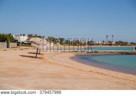 A Sandy Beach With Azure Sea Water