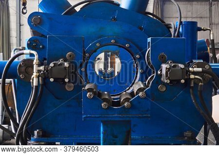 Industrial Interior With Steady Rest Of Huge Lathe In The Foreground