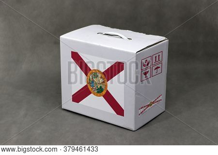 Florida Flag On White Box And State Flag Barcode With Fragile Symbol On Grey Background. The Concept