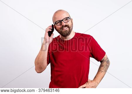 Man Portrait With Cellphone. Man Portrait While Speaking On Cellphone. Cheerful Man Speaking On Cell