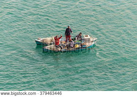 El Qantara, Egypt - November 14, 2019: Fishermen In Wooden Boat On The Suez Canal In Egypt.