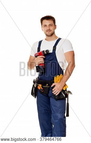 Caucasian Repairman Worker In Uniform Holding Cordless Screwdriver. Handyman Wearing Tool Belt Isola