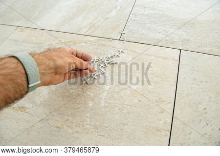 Pov Personal Perspective Worker Installer Holding Multiple Tile Spacers During The Installation Of N