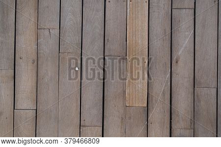 Untreated Vertical Wood Plank Boards With Little White Pebble Background. Natural Wood Texture For B