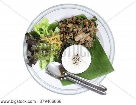 Thai Food Rice Topped With Stir Fried Pork And Basil Served With Vegetables Isolated On White Backgr