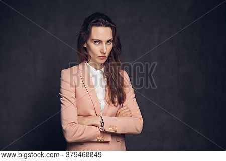 Offended Adult Caucasian Woman On Grey Dark Background With Copy Space