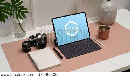 Cropped Shot Of Mock Up Digital Tablet With Keyboard And Stylus On Worktable