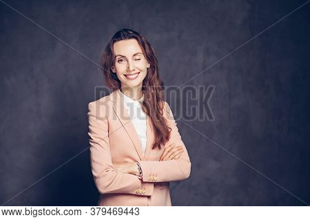 Winking Adult Caucasian Woman On Grey Dark Background With Copy Space