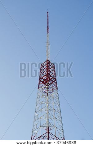 TV RADIO TOWER AGAINST A BLUE SKY