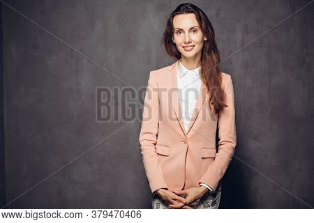 Smiling Adult Caucasian Woman On Grey Dark Background With Copy Space