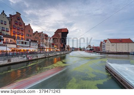 Gdansk, Poland - August 2, 2020: Amazing architecture of Gdansk old town at dusk from a new footbridge over the Motlawa River. Poland