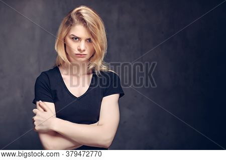 Angry Young Caucasian Woman On Dark Background