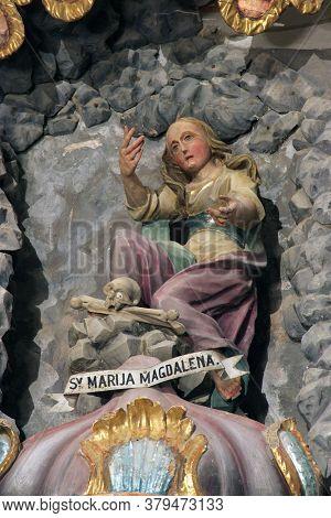 SVETI PETAR OREHOVEC, CROATIA - JUNE 26, 2013: Saint Mary Magdalene statue on the Altar of the Holy Three Kings in the Church of St. Peter in Sveti Petar Orehovec, Croatia