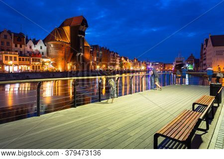 Gdansk, Poland - August 2, 2020: Amazing architecture of Gdansk old town over the Motlawa River at night. Poland