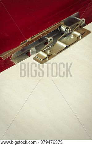 Red Paper Folder With Clip Close-up. Open Folder With A Metal Clip. Office Work, Stationery. Copy Sp