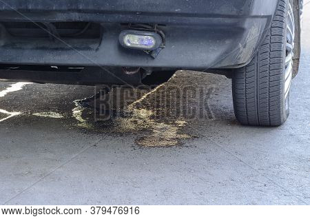 Leakage Of Antifreeze On The Asphalt From Parked Car. Defective Technical Condition. Environmental P
