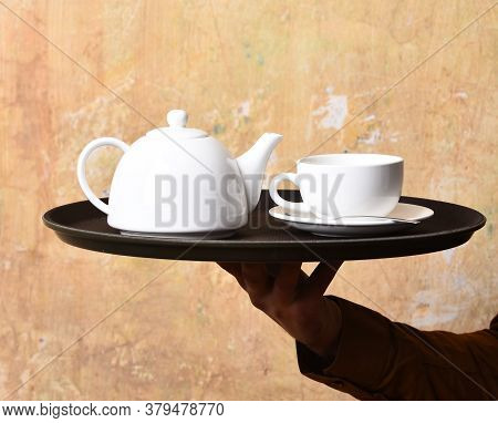 Barman Brings Tea Or Coffee. Service And Restaurant Catering Concept