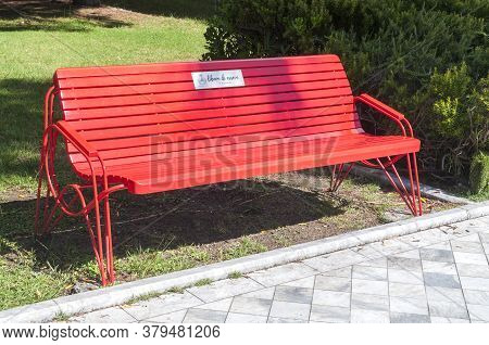 Forte Dei Marmi, Italy - August 5, 2020 - A Red Bench Entitled