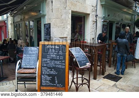 Nimes / France / 4 April 2011 : A Street Bar - Cafe In The Old Town. Handwritten Menu Boards List Th