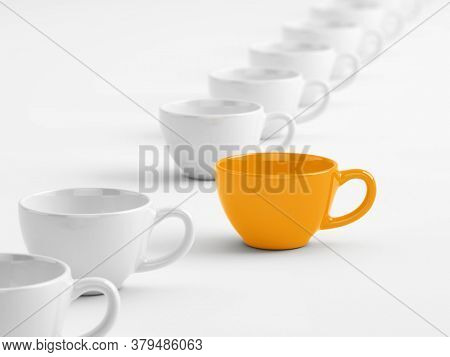 Unique and Exception Concept. Cups are in a row, orange cup separately. Isolated on white. 3d rendering