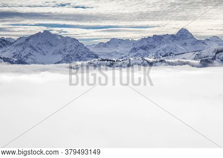 Snow Covered Mountains With Inversion Valley Fog And Trees Shrouded In Mist. Scenic Snowy Winter Lan