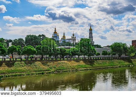 Kharkiv Cityscape (ukraine) With The Lopan River And The Domes Of The Dormition Cathedral And Pokrov