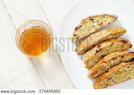 Sweet Cantuccini Biscuits And Sweet Wine. Homemade Italian Biscotti Cookies On Woden Table.