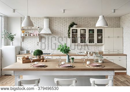 Modern Kitchen At Home With White Interior, Refrigerator, Tableware On Dining Table, Kitchenware Sup