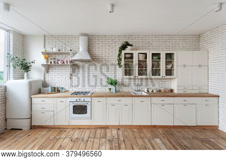Modern Kitchen Facade At Home With White Interior, Refrigerator, Gas Stove Appliance, Cooking Hood,