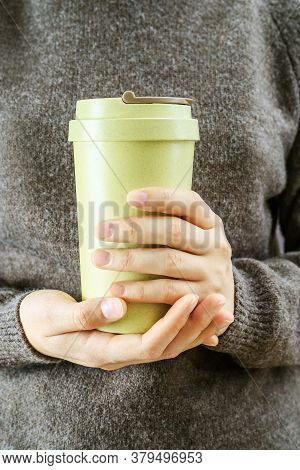 Girl Holds In Her Hands Bamboo Cup. Zero Waste Concept. Take Away Coffee In Reusable Eco Thermo Mug.