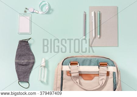 Work Space New Normal Concept. School Bag And School Accessories, Face Medical Mask And Hand Sanitiz