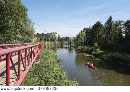 Lokeren, Belgium, July 13, 2020, Red Canoe Sails On The Water Of The Durme To The City Center