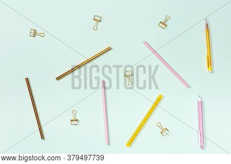 Flat Lay With Stationery For School Or Office. Pink And Golden Colored Pencils, Pens And Metal Paper