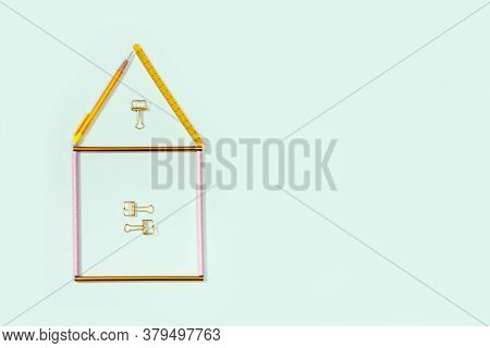 Flat Lay With Stationery For School Or Office. House Or Home From Pink And Golden Colored Pencils, P