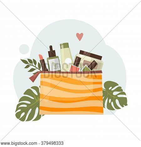The Concept Of Using Organic Cosmetics And Nature Conservation. Image Of A Cosmetic Bag Surrounded B