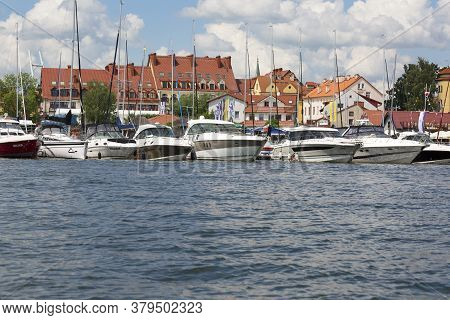 Mikolajki, Masuria, Poland - June 24, 2020: View From Mikołajskie Lake Of Town, Marina For Yachts An