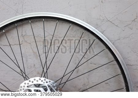 A Double Rim Of A Bicycle Wheel Without A Tire, Against A Background Of A Textured Eraser. Bicycle W
