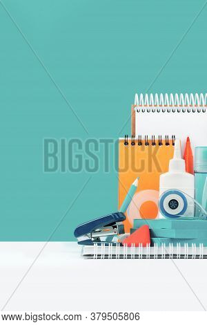 Group Of Office And School Yellow Orange And Teal Stationery On Desk. Various Supplies For Back To S