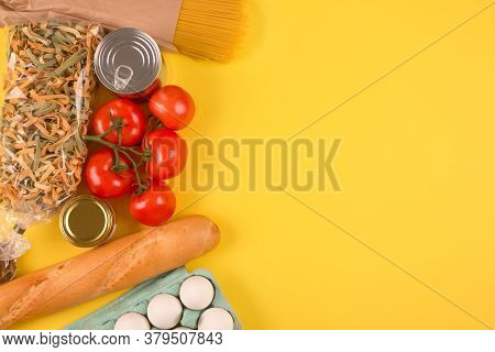 Flat Lay Composition With Food Donations On Yellow Background With Copyspace - Pasta, Fresh Vegatabl