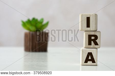 Ira (individual Retirement Account) - Acronym On Wooden Cubes On A Light Background With A Cactus. B