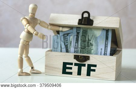 Etf (exchange Traded Funds) - Word On Wooden Chest On A Light Background With A Wooden Man. Business