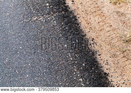 Rural Asphalt Road Border And Roadside. Abstract Transportation Background Photo With Selective Soft
