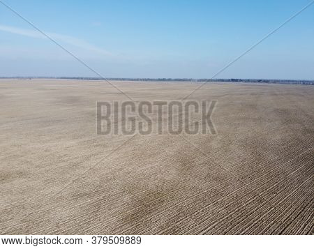 Agricultural Fields On A Sunny Spring Day, Aerial View. Landscape. Blue Sky Over The Fields.