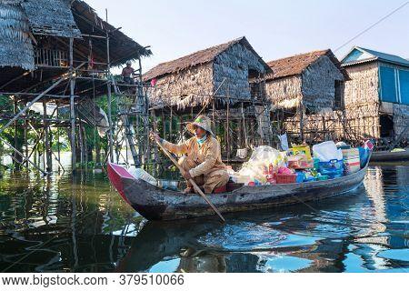 KAMPONG KHLEANG, SIEM REAP, CAMBODIA - CIRCA NOVEMBER 2018: Stilt houses line on Tonle Sap lake in the floating village of Kampong Khleang, Siem Reap in Cambodia.